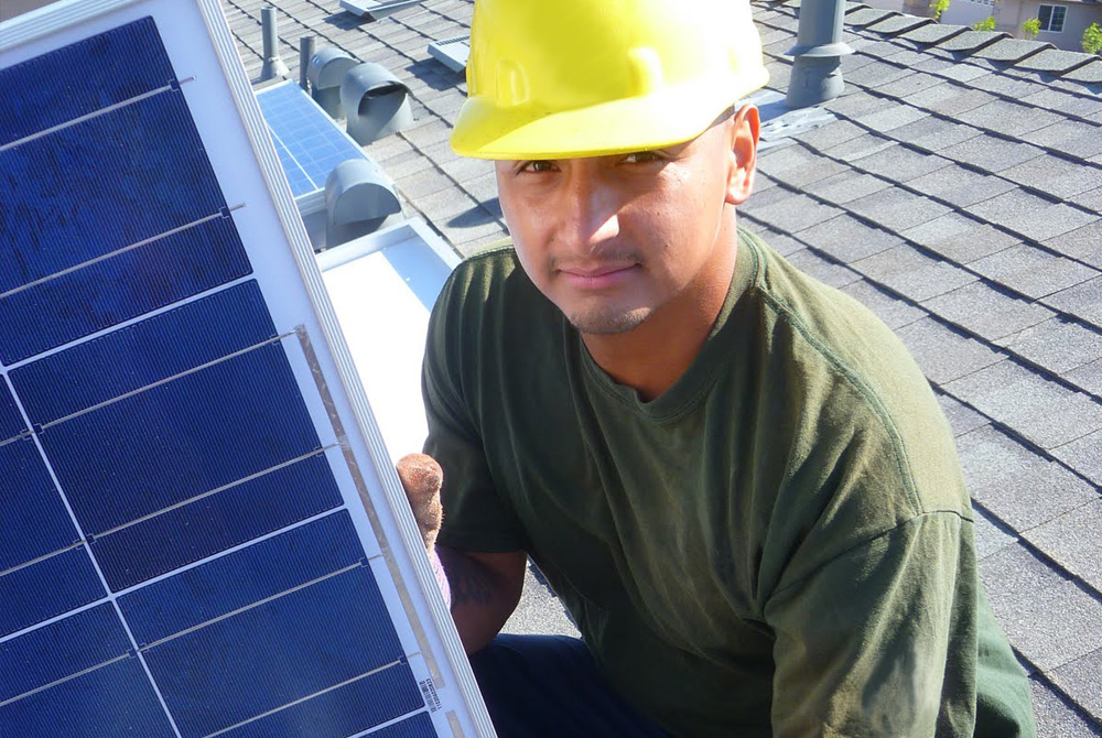 SOMAH contractor installing solar panels on roof