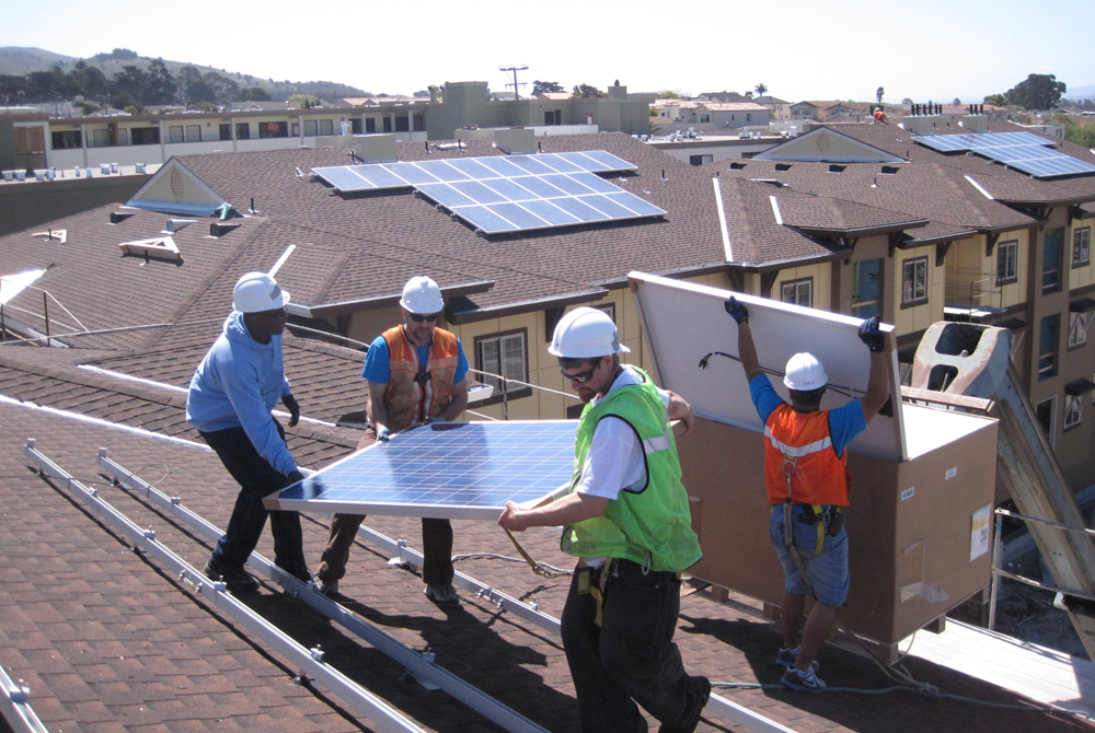 SOMAH job trainees learning to install solar panels