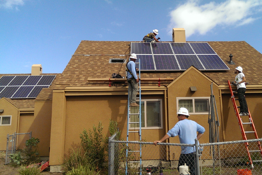 Solar educators providing hands-on training to potential job candidates