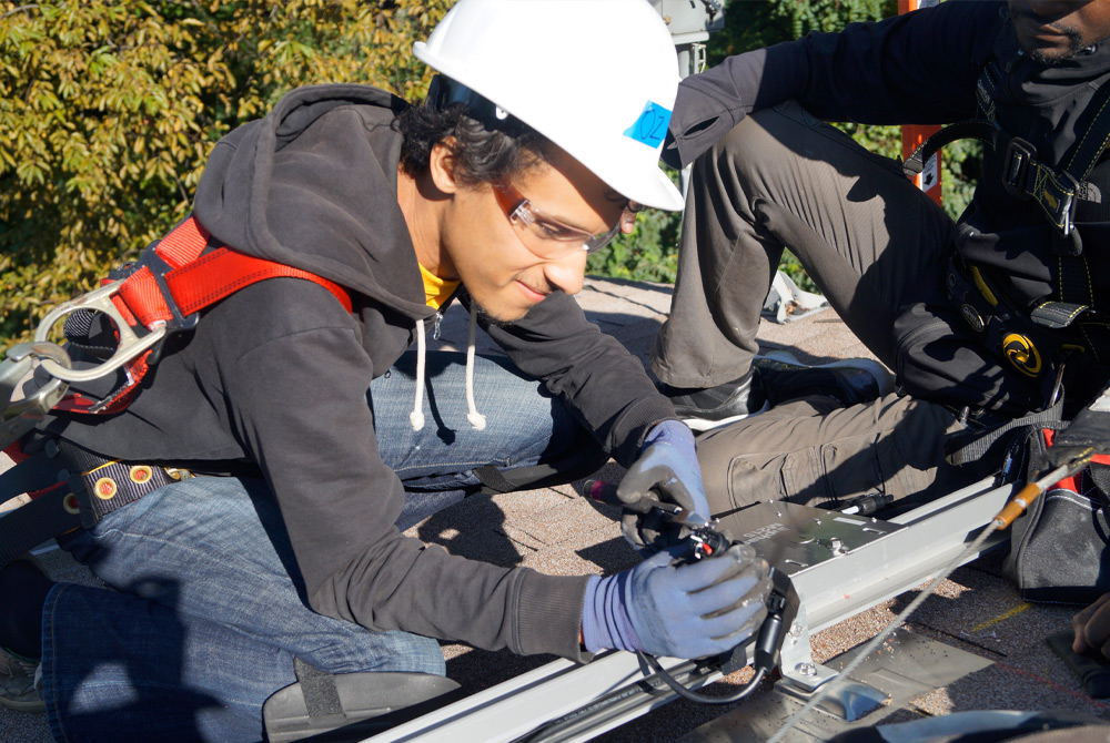 New student receiving hands-on solar installation job training